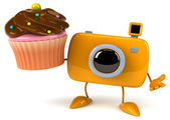 Fun camera with cupcake — Stock Photo