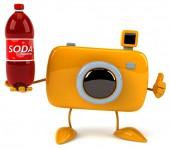 Fun camera with bottle of soda — Stock Photo