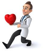 Fun cartoon doctor with red heart — Stockfoto