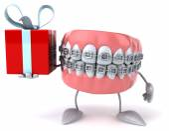 Fun teeth with gift — Stock Photo