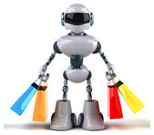 Fun robot with shopping bags — Stock Photo