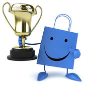 Fun shopping bag with trophy — Stock Photo