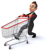Fun businessman with shopping cart — Stock Photo