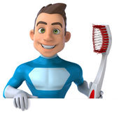 Fun superhero with toothbrush — Stock Photo