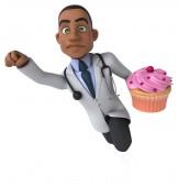 Fun doctor with cupcake — Stock Photo
