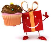 Fun gift with cupcake — Stock Photo