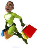 Fun superhero with shopping bags — Stock Photo