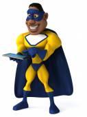 Fun superhero with tablet computer — Stockfoto