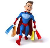 Fun cartoon superhero shopping — Stock Photo
