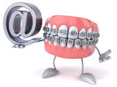 Fun teeth with email symbol — Stock Photo
