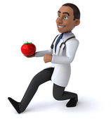 Fun doctor with red tomato — Stock Photo