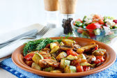 Roasted vegetables on a rustic plate — Stock Photo