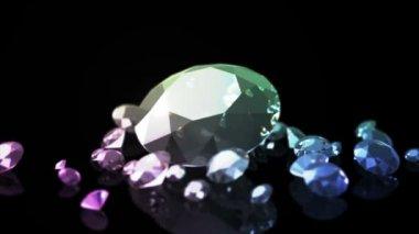 Diamonds on a black background with a beautiful gradient illumination — Video Stock