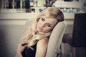 Romantic woman at restaurant thinking — Stock Photo