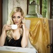 Vintage woman drinking coffee — Stock Photo #53361353