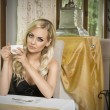 Girl with cup of tea in vintage cafe — Stock Photo #53361577