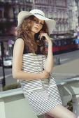 Woman in striped dress — Stock Photo