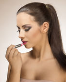 Girl with lipstick — Stock Photo