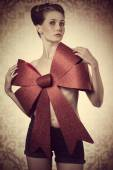 Sexy girl adorned with bow  — Stock Photo
