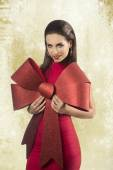 Sensual girl with big christmas bow  — Stock Photo