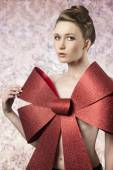 Sexy female adorned like a gift  — Stock Photo