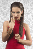 Charming brunette with red dress — Stock Photo