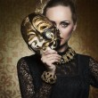 Antique lady with gothic mask — Stock Photo #64325337