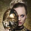 Close-up of girl with baroque mask — Stock Photo #64325399