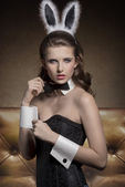 Pin-up girl with funny bunny ears  — Stock Photo