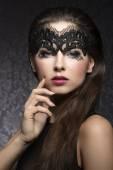Brunette in black mask — Stock Photo