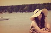 Vintage color effect , sweet portrait of summer girl near lake — Stock Photo