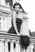 Fashion woman on ancient balcony in BW — Stock Photo