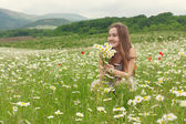 10-years old girl laughing on the meadow — Stock Photo