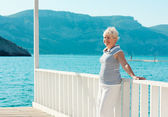 Mid aged woman on the seaside — Stock Photo