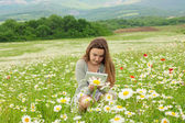 10-years old girl on the meadow with tablet pc — Stock Photo