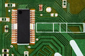 Electronic circuit board with chip and radio components — Stock Photo