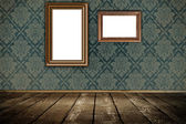 Old wooden frames on a grunge wall. — Stock Photo