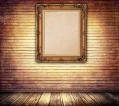 Decorative vintage wooden frame on bricks wall. — Stock Photo