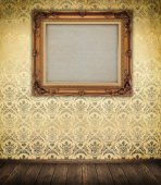 Old-fashioned wooden frame on a wall. — Stock Photo