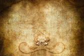 Old grunge paper background with floral pattern. — Stock Photo