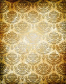 Old grunge paper background with floral european patterns. — Stock Photo