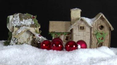 Paper house with falling christmas baubles — Stockvideo