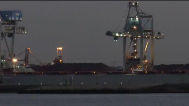 Lights on industry along ship canal — Stock Video