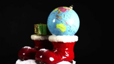 Santa boots with christmas bauble and presents — Stock Video