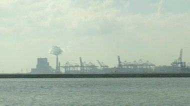 Heavy industry along ship canal — Stock Video