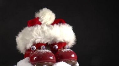 Santa hat on red boots — Stock Video