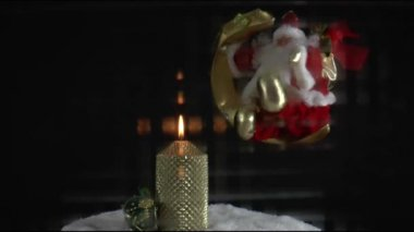 Burning candle and christmas decorations — Stock Video