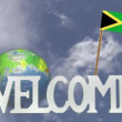 Turning globe and small paper flag of JAMAICA — Stock Video #60533031