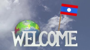 Turning globe and small paper flag of LAOS — Stock Video