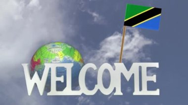 Turning globe and small paper flag of  TANZANIA — Stock Video